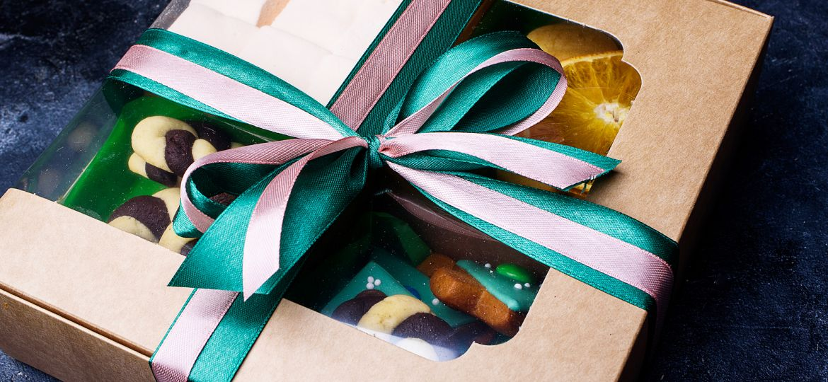 Box With Satin Ribbons And Delicious Treats For New Year And Chr