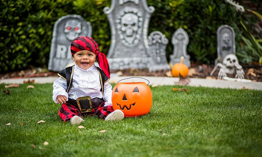 Cute young child in a halloween costume ready to trick-or-trea